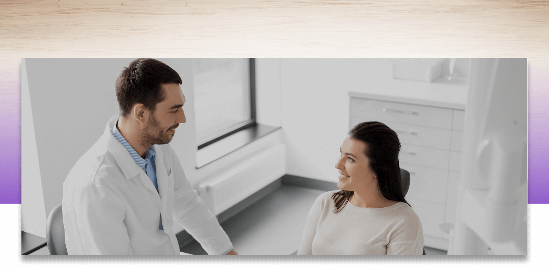 Dentist and patient smiling at each other while discussing
