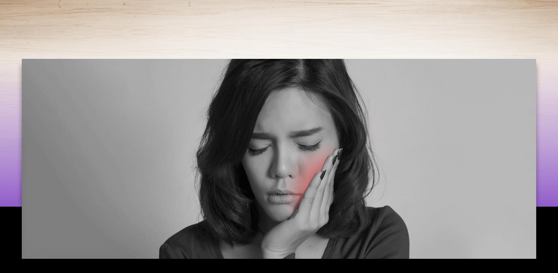Woman in pain touching her cheek