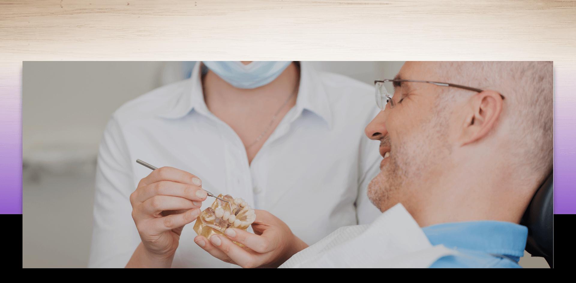 Elderly patient looking at dental apparatus