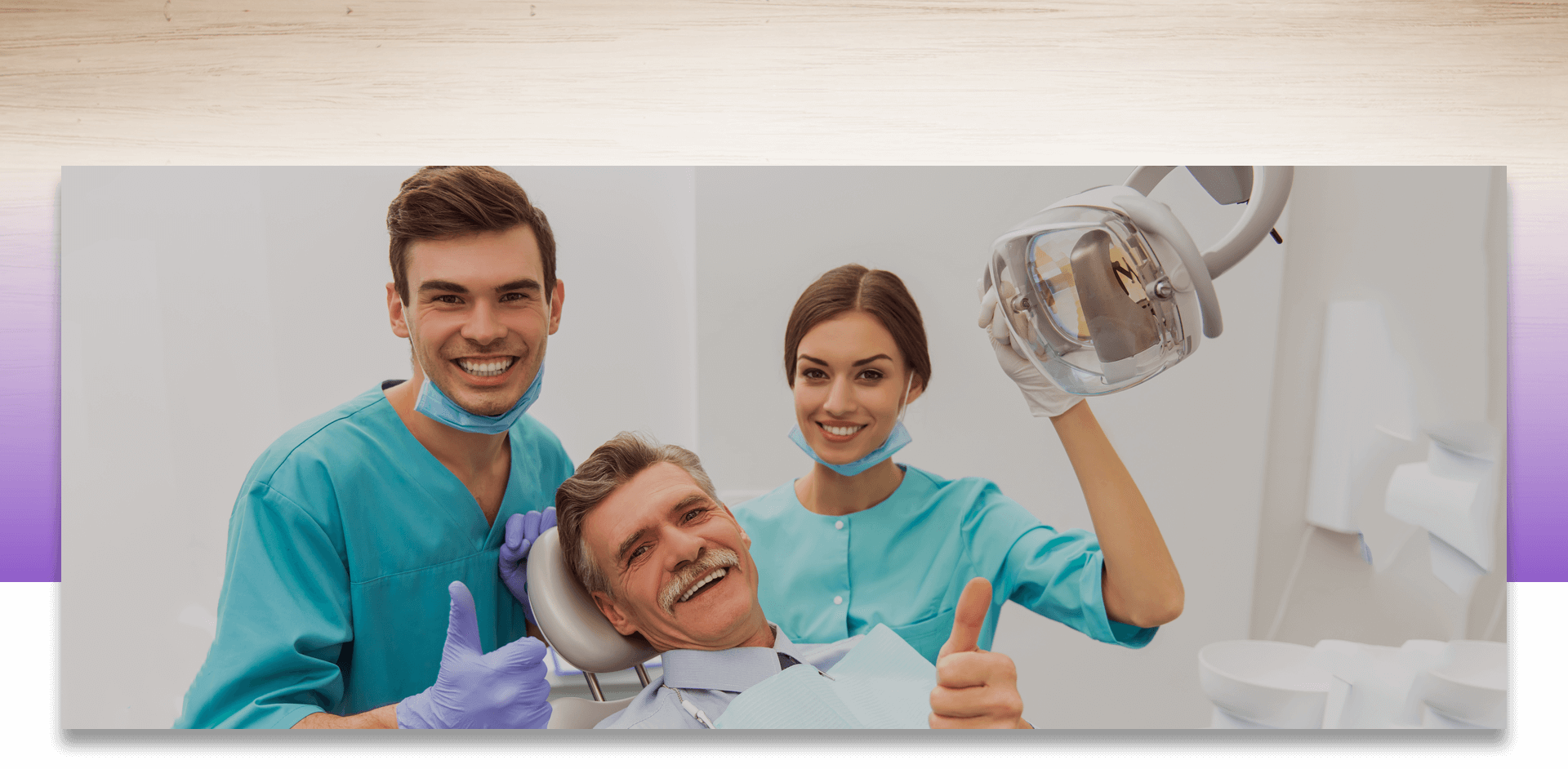 Dentist and patient showing thumbs up and assistant smiling at the camera
