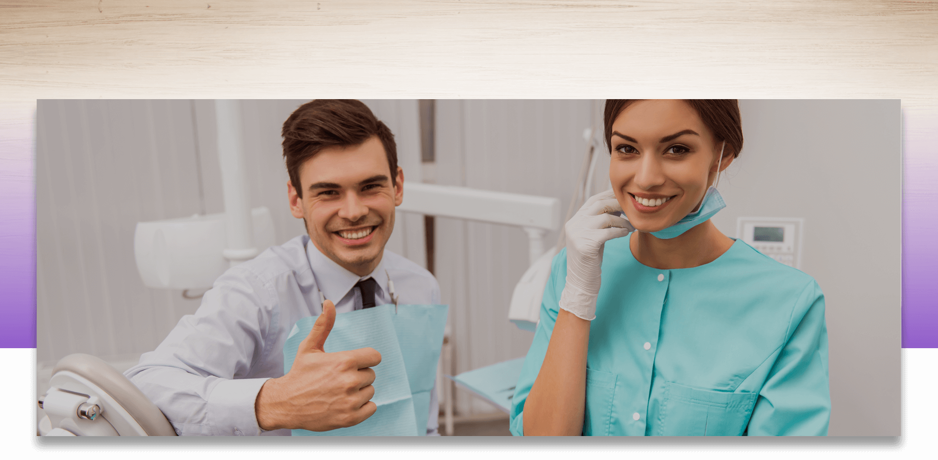 Dentist smiling and showing thumbs up while assistant smiling looking at the camera