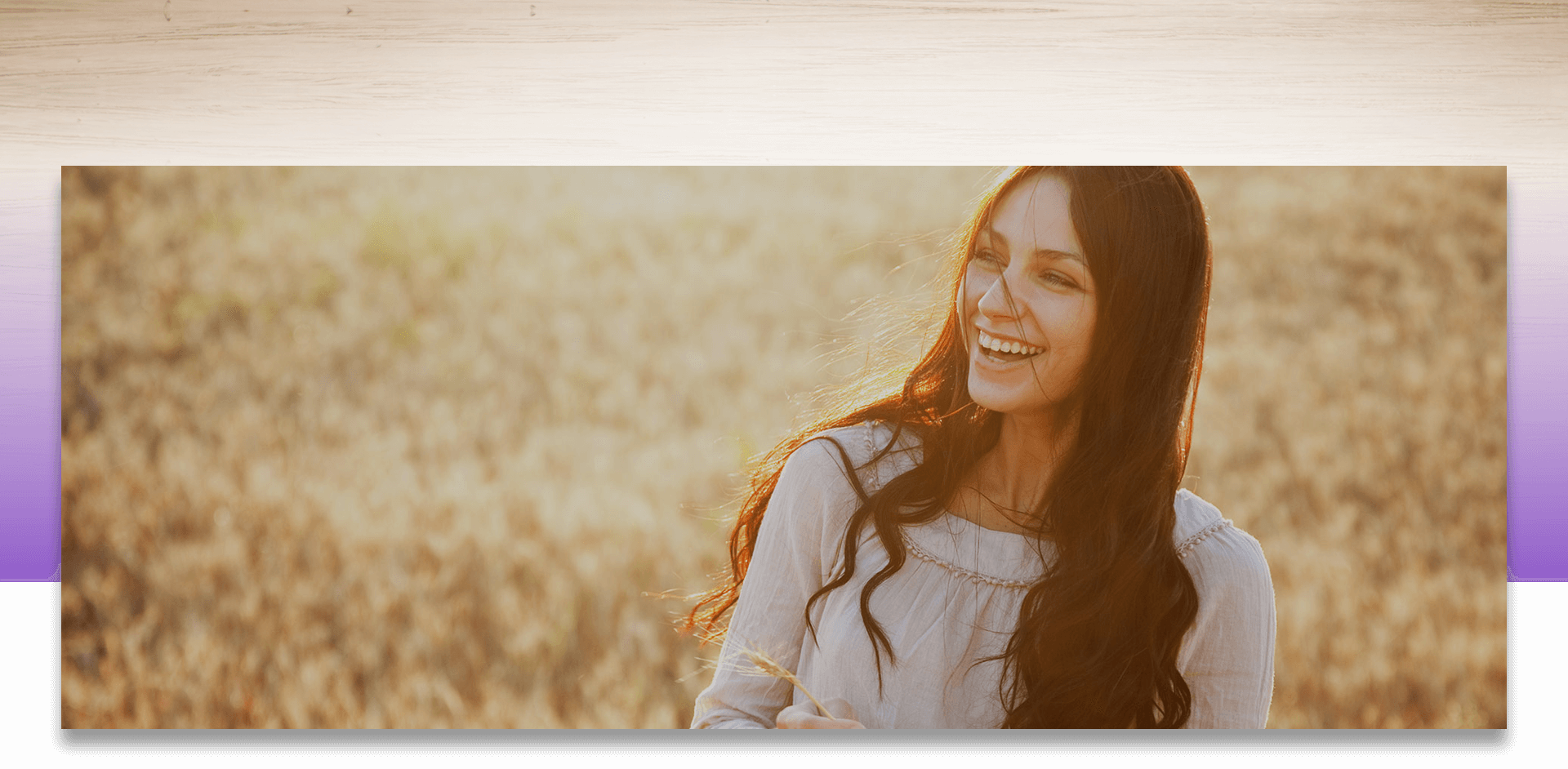 Smiling woman in a wheat field